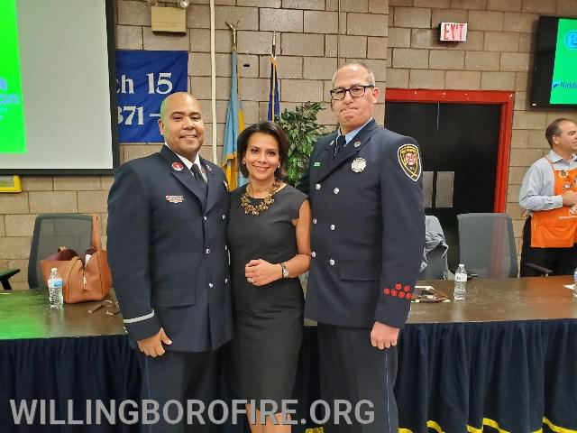 Lieutenant Ferrell (L) and Firefighter Anderson with 6ABC News Anchor and Master of Ceremonies for the event Tamala Edwards